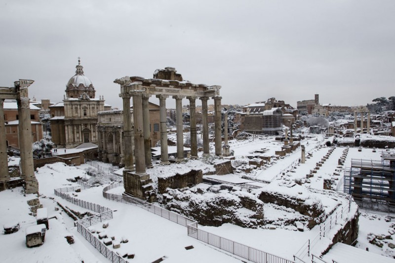 Snow blankets the ancient Roman Forum, in Rome Saturday, Feb. 4, 2012. A rare snowfall blanketed Rome forcing the closure of the Colosseum over fears tourists would slip on the icy ruins, and leaving buses struggling to climb the city's slushy hills. Other parts of the country experienced frigid temperatures unseen in years. Authorities stopped visitors from entering the Colosseum, the adjacent Roman Forum and the Palatine Hill, the former home of Rome's ancient emperors. (AP Photo/Andrew Medichini)